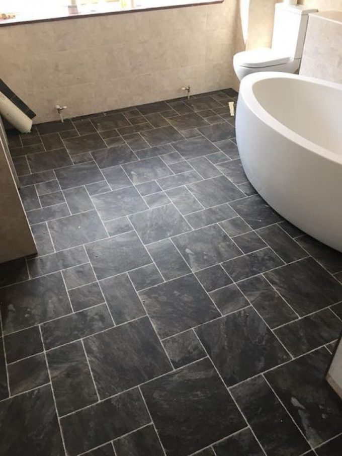 Lifestyle tile vinyl fitted around  free standing oval bath