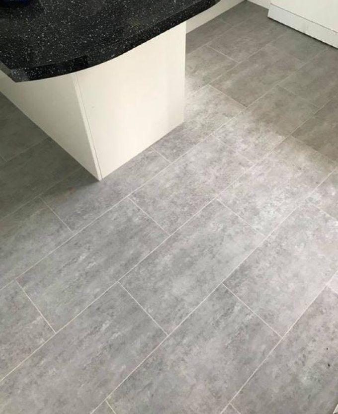 Cavalio Luxury Vinyl Tiles in light grey cement with ice grout strips