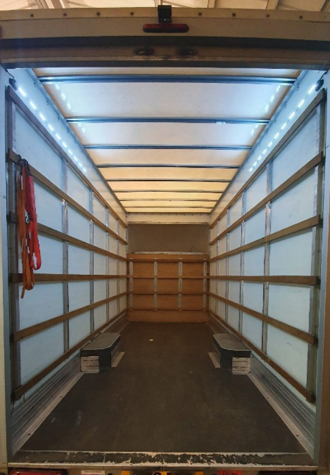Spacious loading space with motion detection lighting, with strappings